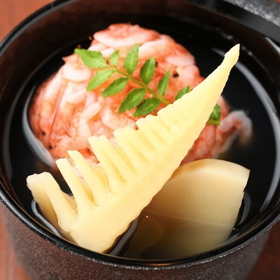 Steamed shrimp dumpling and bamboo shoots in broth.